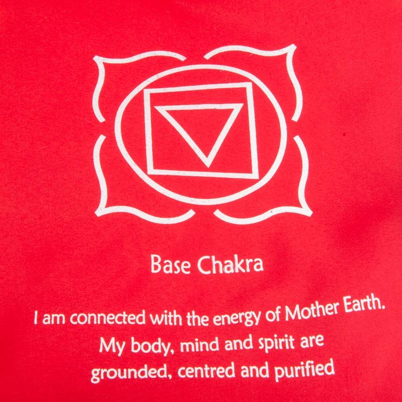 rode vlag basischakra eerste chakra wortelchakra symbool en tekst